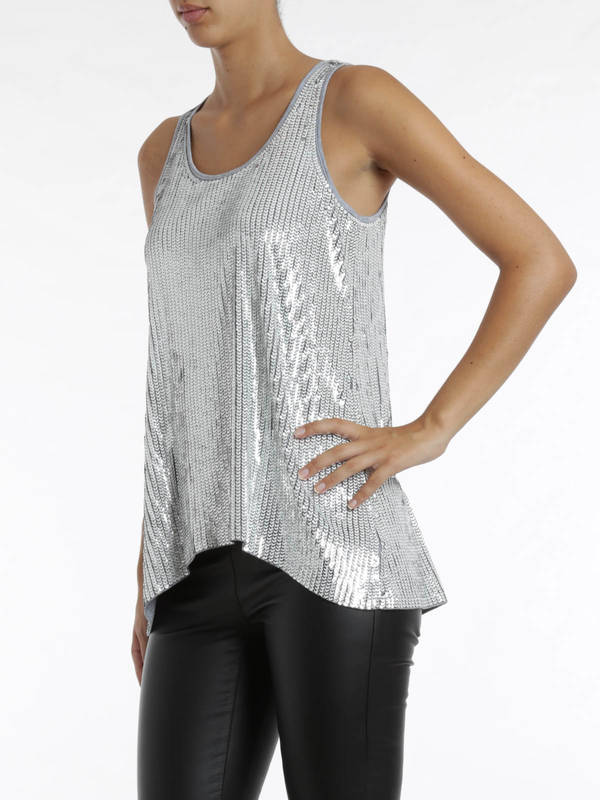 Team a sequined chiffon vest top with studded cargo pants for an effortless everyday look, or opt for a one-shoulder top with a big floral sequin pattern. There's even printed chiffon blouses with sequin detailing, which look great with white jeans or utility shorts.