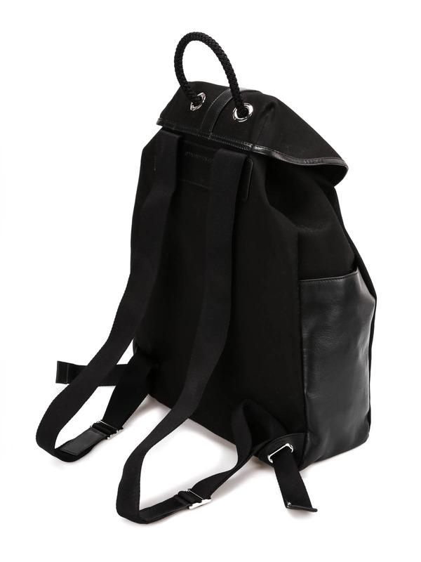 Skull print backpack shop online: ALEXANDER MCQUEEN