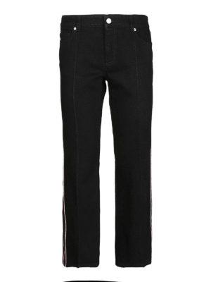 ALEXANDER MCQUEEN: jeans a zampa - Jeans crop svasati con bande laterali