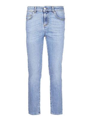 ALEXANDER MCQUEEN: jeans skinny - Jeans crop con stampa logo gotica