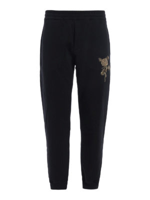 Alexander Mcqueen: tracksuit bottoms - Embroidered rose tracksuit bottoms