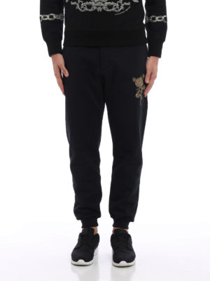 Alexander Mcqueen: tracksuit bottoms online - Embroidered rose tracksuit bottoms