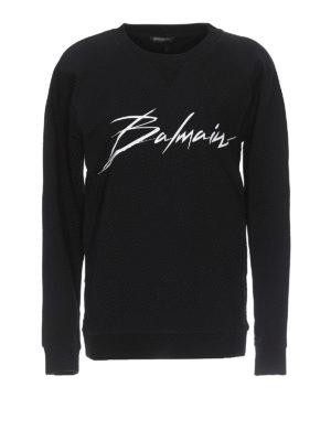 1e564364c Balmain: Felpe e maglie - Felpa in cotone nero con logo lettering. Balmain.  Logo print black cotton sweatshirt