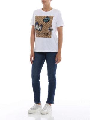 COACH: t-shirt online - T-shirt bianca con ricami tenebrosi