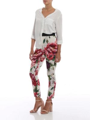 DOLCE & GABBANA: Pantaloni sartoriali online - Pantaloni in seta stretch stampa Peonie