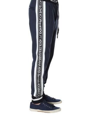 DOLCE & GABBANA: pantaloni sport online - Pantaloni in felpa con logo