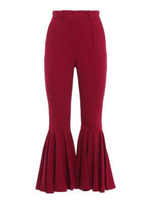 DOLCE & GABBANA: Pantaloni sartoriali - Pantaloni in cady con balza sul fondo
