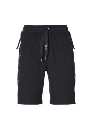 DOLCE & GABBANA: pantaloni sport - Shorts in cotone con patch logo