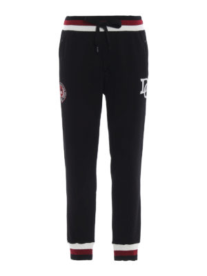 DOLCE & GABBANA: pantaloni sport - Pantaloni neri da tuta con logo DG