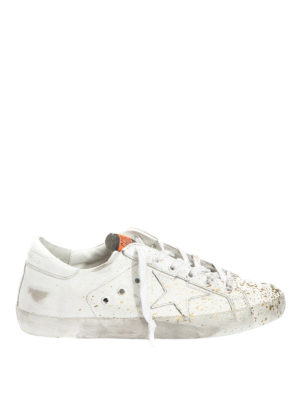 Golden Goose: trainers - Superstar gold spotted sneakers