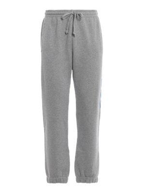 GUCCI: pantaloni casual - Pantaloni della tuta in cotone con logo