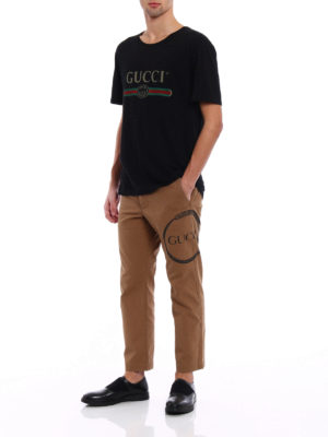 Gucci: casual trousers online - Ouroboros print worker chino pants