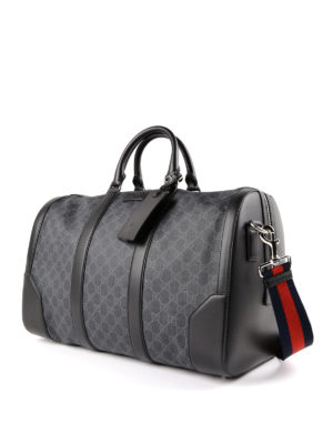Gucci: Luggage & Travel bags online - GG Supreme carry-on duffle bag