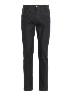 Gucci: straight leg jeans - Back tiger patch slim jeans