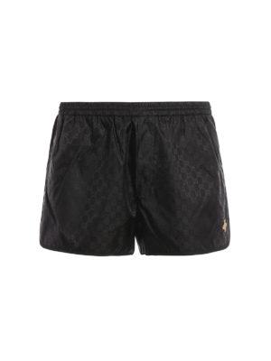 Gucci: Swim shorts & swimming trunks - Embroidered bee GG swim shorts