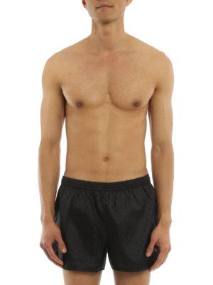 Gucci: Swim shorts & swimming trunks online - GG Supreme swim shorts