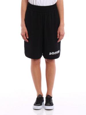 Marcelo Burlon: Trousers Shorts online - Guernica shorts