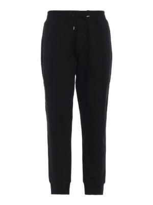 MCQ: pantaloni sport - Joggers in cotone con stampa mcq ripetuta
