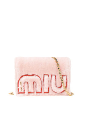Miu Miu: cross body bags - Logo shearling crossbody