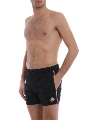 Moncler: Swim shorts & swimming trunks online - Bands detailed nylon swim shorts