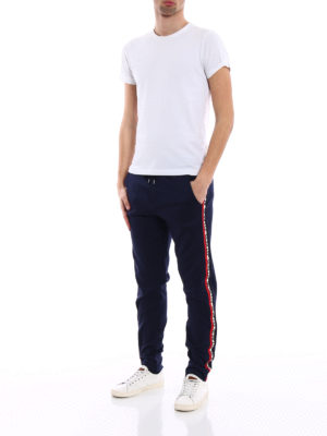 Moncler: tracksuit bottoms online - Logo band detail blue track pants