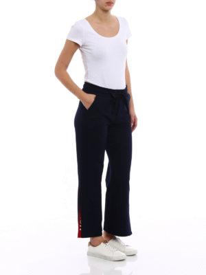 Moncler: tracksuit bottoms online - Side vents cotton tracksuit bottoms