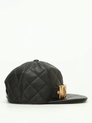 Moschino: hats & caps online - Gold logo quilted leather hat