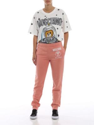 MOSCHINO: pantaloni sport online - Pantaloni da jogging in cotone color salmone