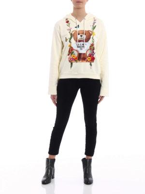 Moschino: Sweatshirts & Sweaters online - Rubberized flower print hoodie
