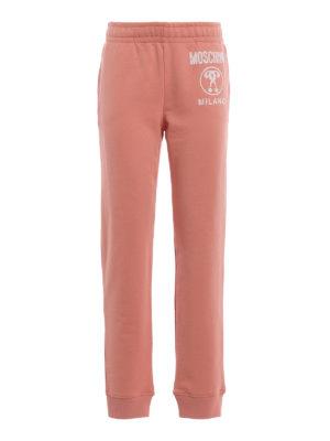 MOSCHINO: pantaloni sport - Pantaloni da jogging in cotone color salmone