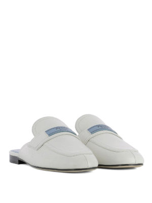 Prada: Loafers & Slippers online - Logo patch leather slippers