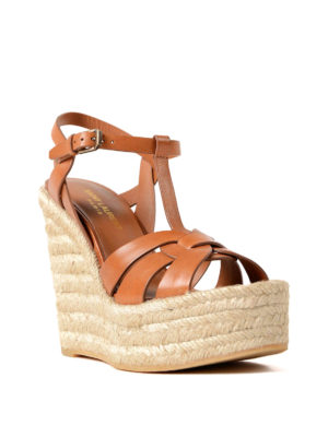 Saint Laurent: sandals online - Leather sandals with jute wedge