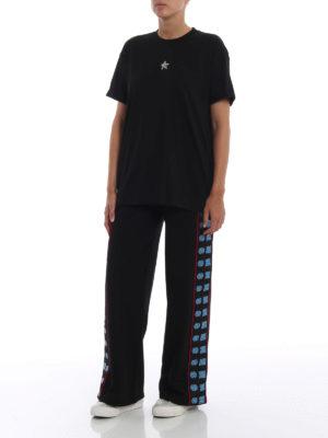 STELLA McCARTNEY: pantaloni sport online - Pantaloni della tuta con bande logo