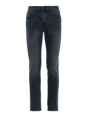 STONE ISLAND: jeans skinny - Jeans skinny con logo dietro