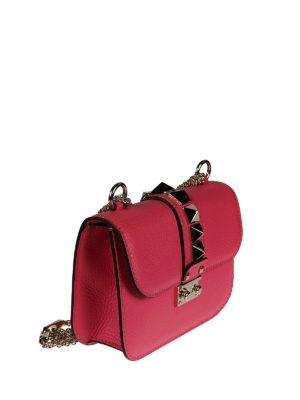 Valentino Garavani: cross body bags online - Studded fuchsia leather crossbody