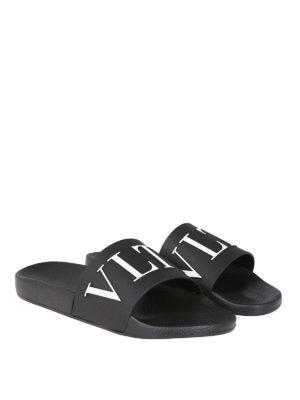 VALENTINO GARAVANI: sandali online - Sandali neri in gomma con logo VLTN