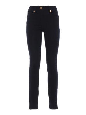 VERSACE: jeans skinny - Jeans skinny scuri con Testa di Medusa
