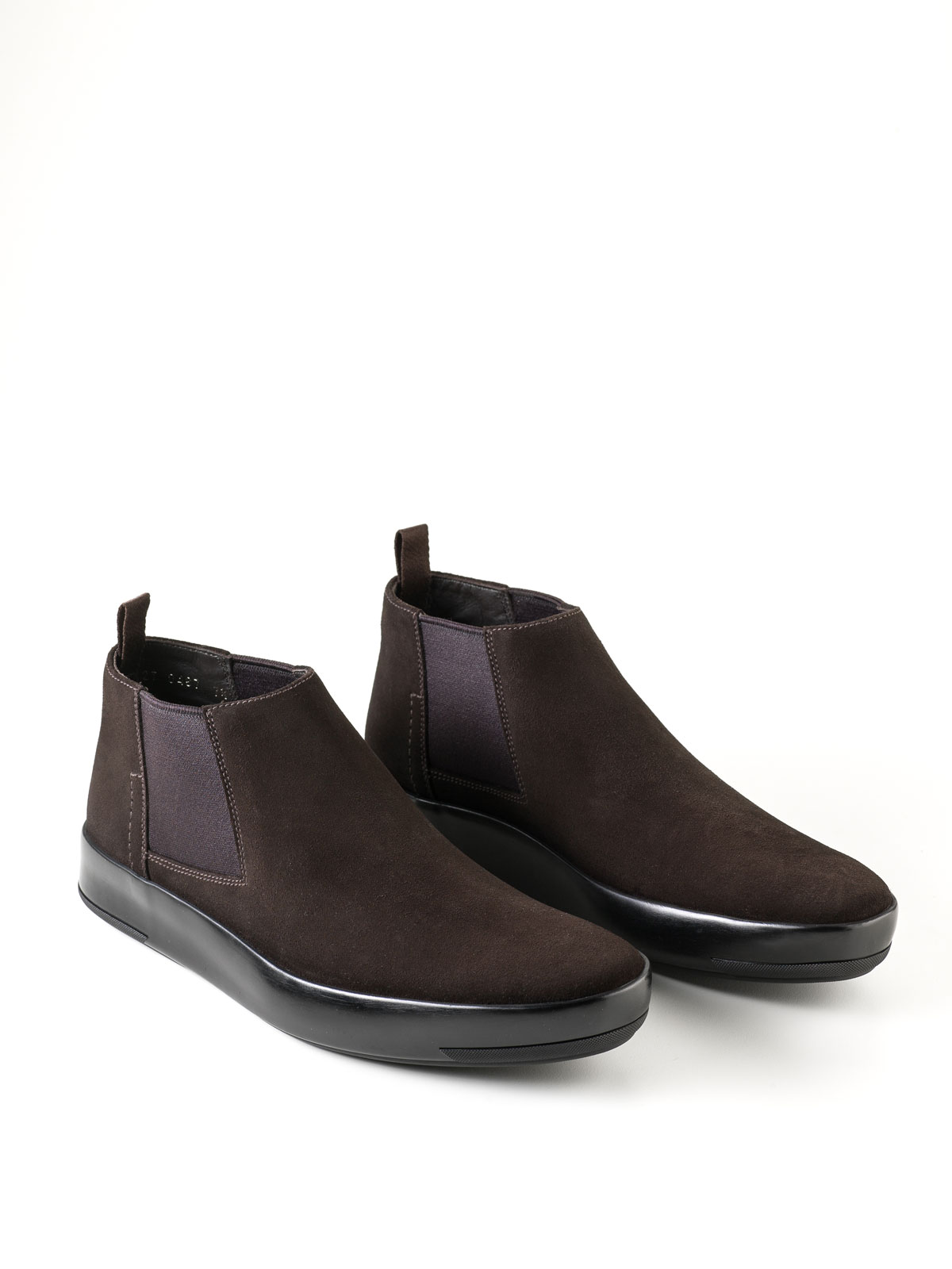 flat cape but ankle boots by prada ikrix