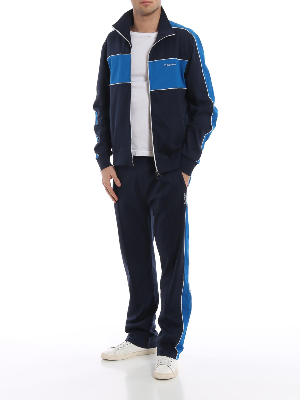 brand new fc2f4 f86cc Calvin Klein - Pantaloni da tuta con bande laterali ...