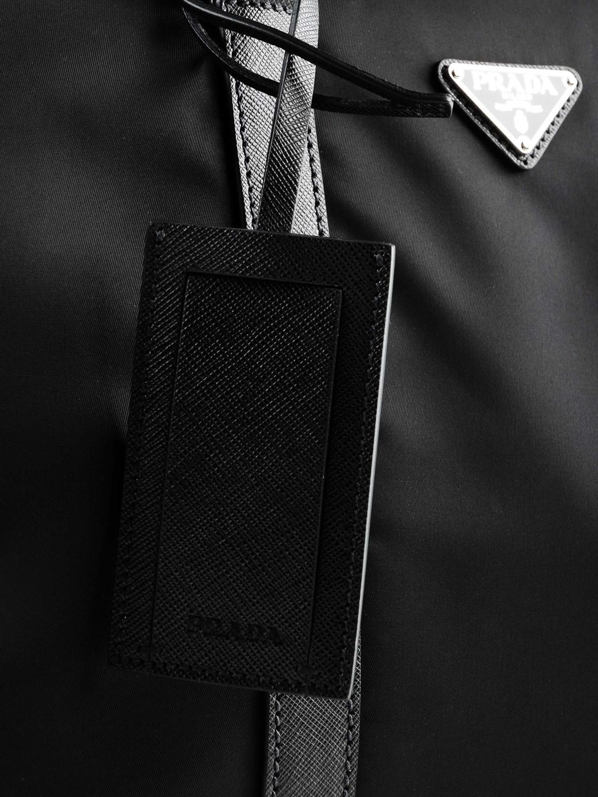 cf9b141027c9 Prada - Fabric travel duffle bag with leather details - Luggage ...