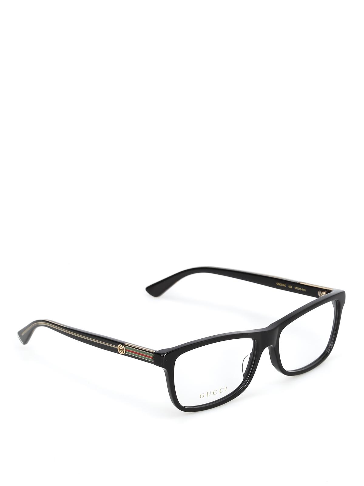 f6047acd499f4 Gucci - Acetate black eyeglasses with golden details - glasses ...