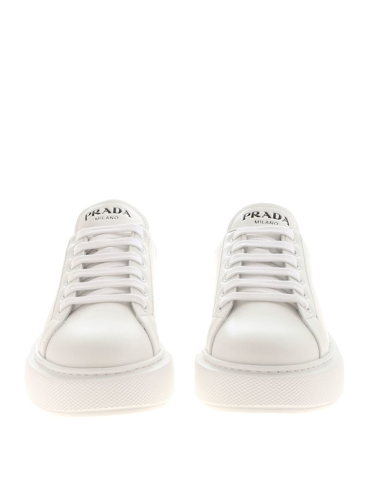Sneakers in white featuring silver heel