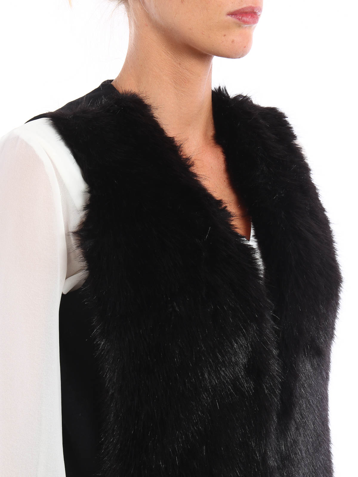 Layer yourself in glam faux-fur and keep out the brrr! This G.I.L.I. faux-mink vest with easy dolman sleeves dresses you in the coziest must-have of the season/5(37).
