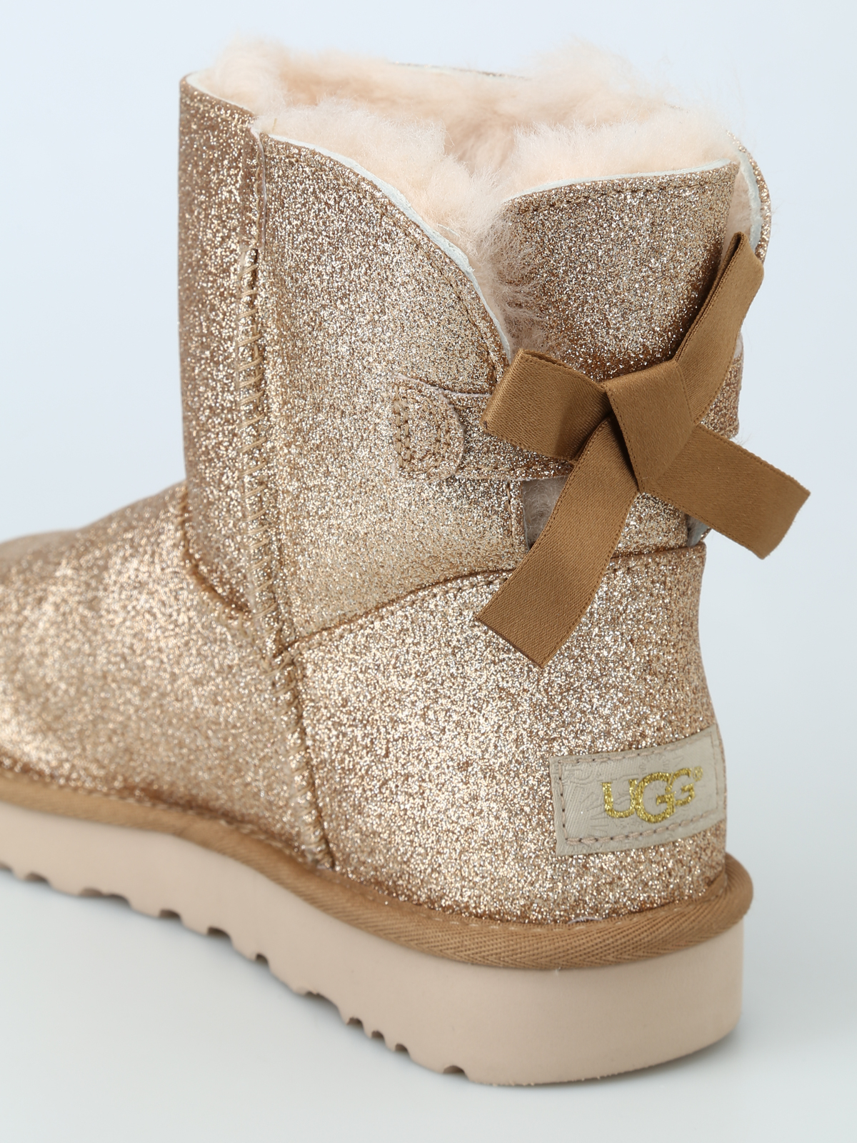 a00e4195ca5 Ugg - Mini Bailey Bow Sparkle gold ankle boots - ankle boots ...