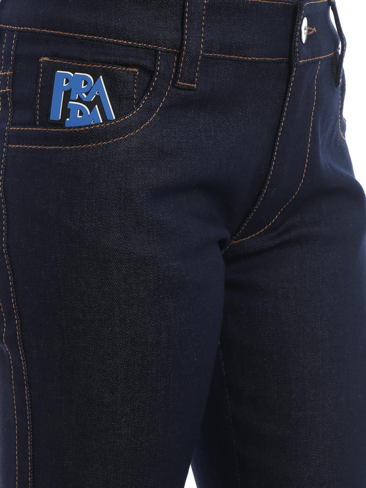 new style 25df4 023d7 Prada - Denim jeans with rubber logo - straight leg jeans ...