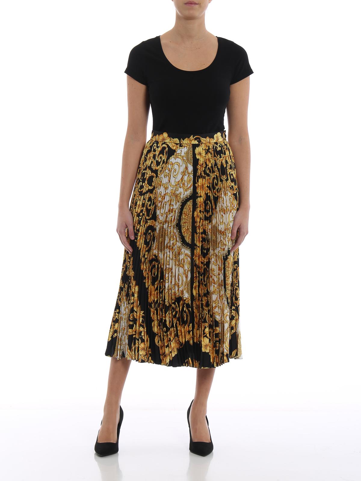 b62e16987 VERSACE: Knee length skirts & Midi online - Gold Hibiscus print silk  pleated midi skirt